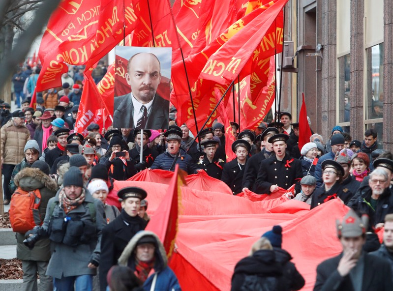 Demonstrators carry a giant Soviet flag during a rally held by Russian Communist party to mark the Red October revolution's centenary in central Moscow