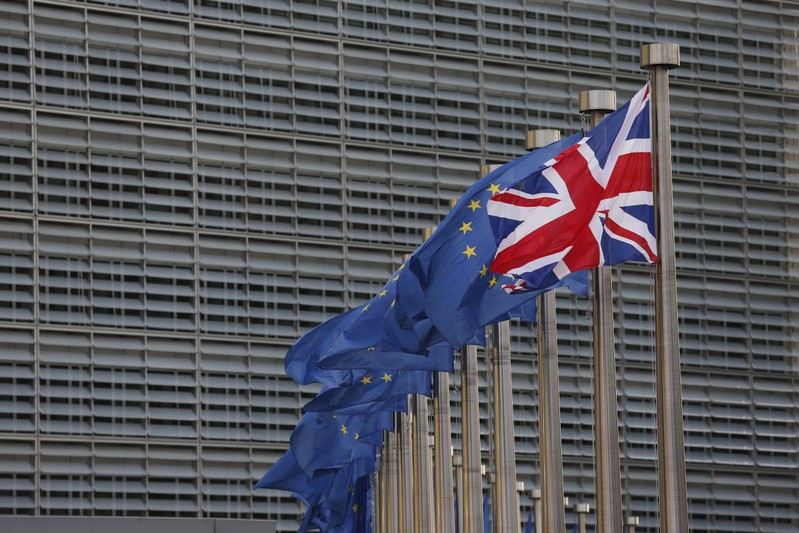A Union Jack flag flutters next to European Union flags ahead of a visit of Britain's Prime Minister Theresa May and Britain's Secretary of State for Exiting the European Union David Davis at the European Commission headquarters in Brussels