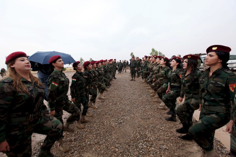 Female Kurdish Peshmerga take part in a training session during German Defence Minister Ursula von der Leyen's at a camp in Banslawa in Arbil