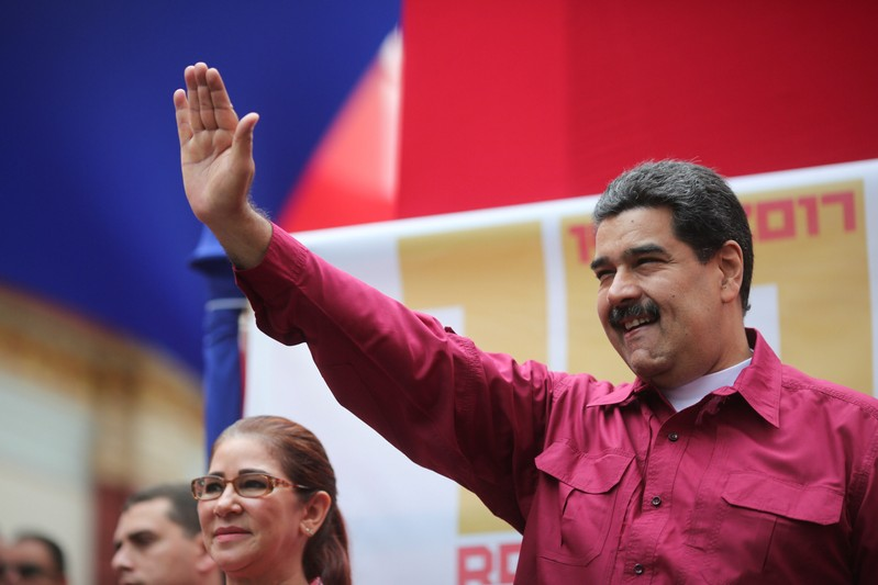 Venezuela's President Nicolas Maduro waves as he arrives for a rally with supporters in Caracas
