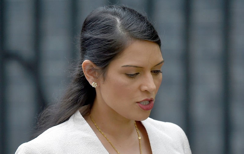 FILE PHOTO: Britain's Employment Minister Priti Patel, leaves after a cabinet meeting in Downing Street in central London
