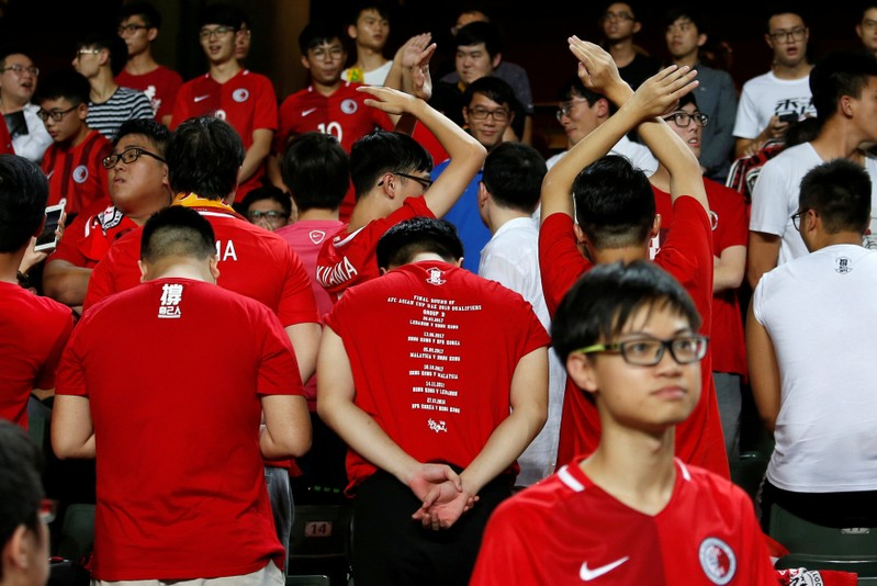 FILE PHOTO - Hong Kong fans turn their backs during the Chinese national anthem in Hong Kong
