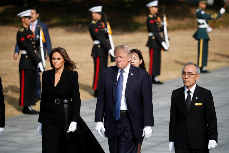 U.S. President Donald Trump and first lady Melania Trump arrive at the National Cemetery in Seoul
