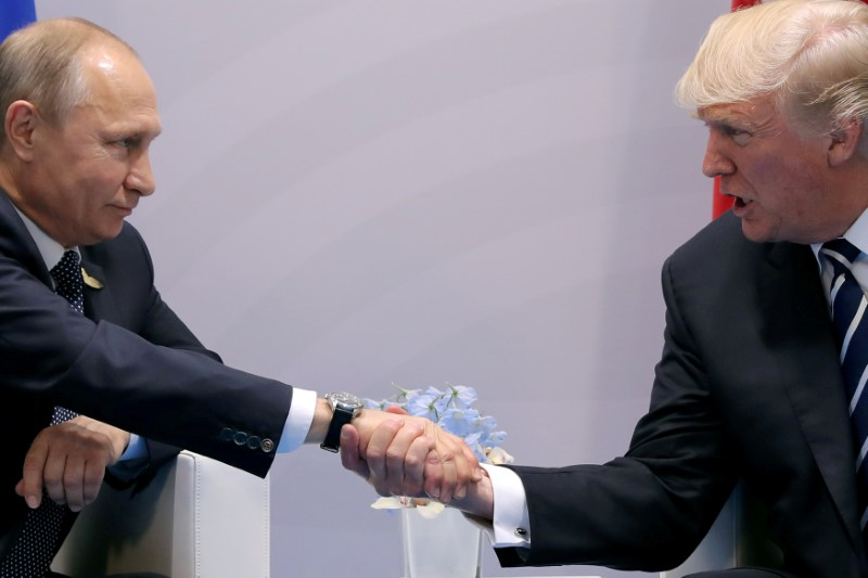 FILE PHOTO - U.S. President Donald Trump shakes hands with Russian President Vladimir Putin during the their bilateral meeting at the G20 summit in Hamburg