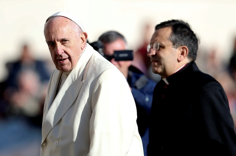 Pope Francis looks as he arrives during his Wednesday general audience in Saint Peter's square at the Vatican