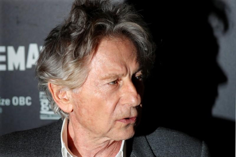 FILE PHOTO: Film director Roman Polanski poses prior to the screening of his movie