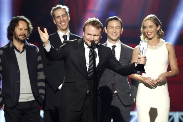 FILE PHOTO: Director Rian Johnson reacts after accepting the award for