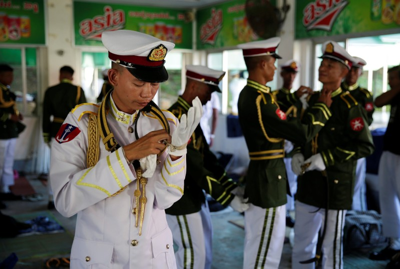 Members of the honour guard put on their uniforms before the arrival of Pope Francis at the Presidential Palace in Naypyitaw, Myanmar