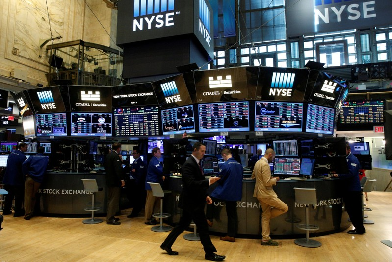 FILE PHOTO: Traders work at the Citadel Securities post on the floor of the NYSE