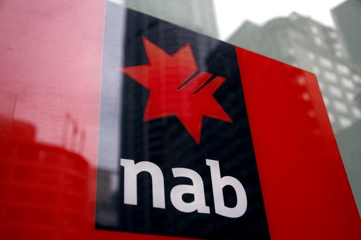 FILE PHOTO: National Australia Bank logo is pictured on an automated teller machine in central Sydney