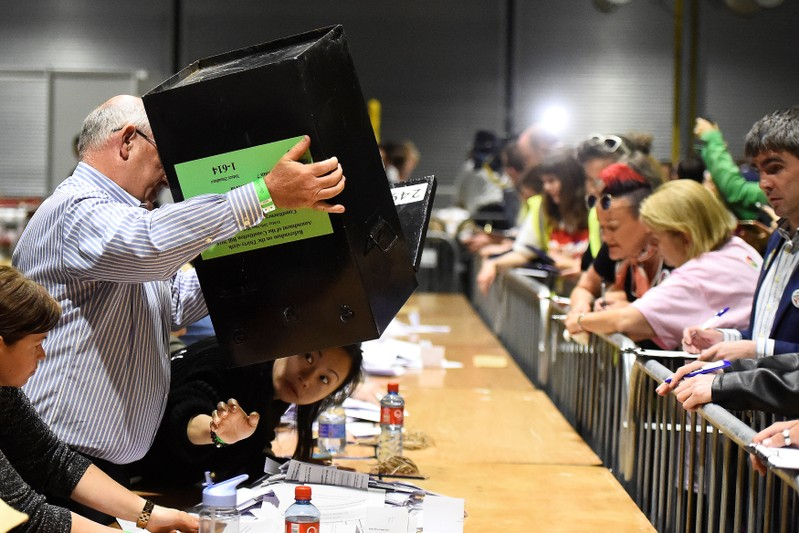 Woman checks underneath a ballot box after the Abortion Referendum in Dublin