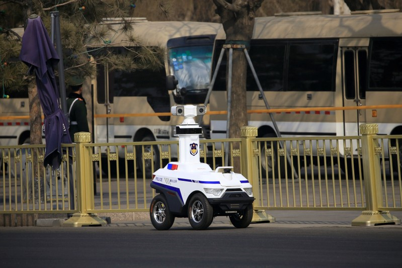 FILE PHOTO: A police robot patrols before the third plenary session of the Chinese People's Political Consultative Conference (CPPCC) in Beijing