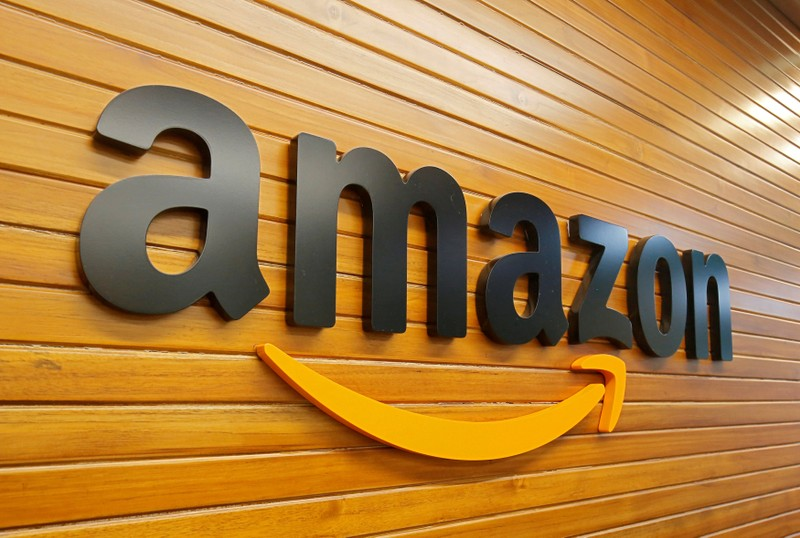 FILE PHOTO: The logo of Amazon is pictured inside the company's office in Bengaluru