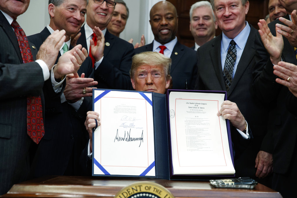 It's the law: Trump signs off on reg relief bill