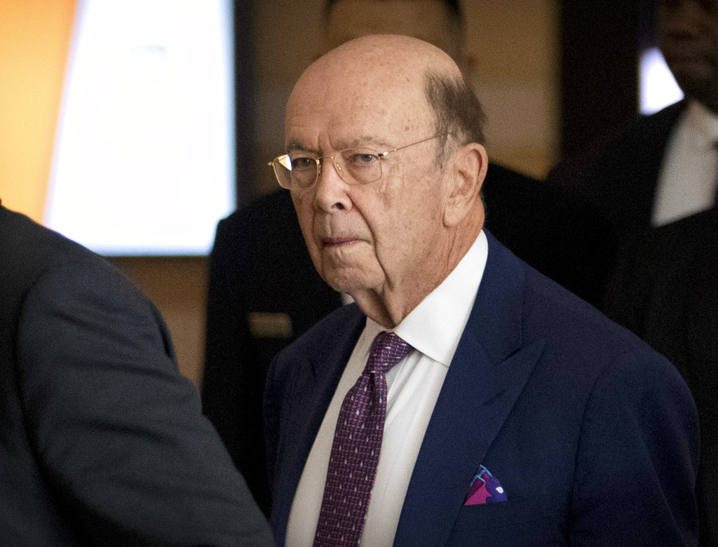 U.S. Commerce Secretary Wilbur Ross leaves his hotel in Beijing