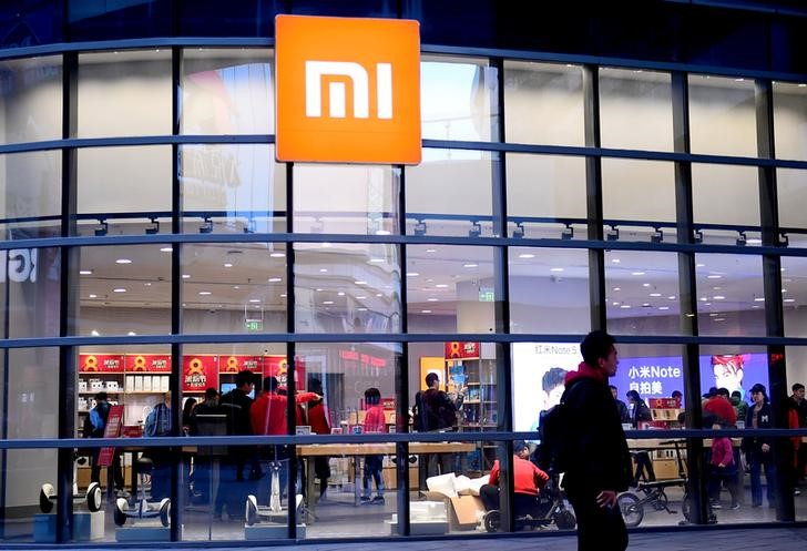 Man walks past a Xiaomi store in Shenyang