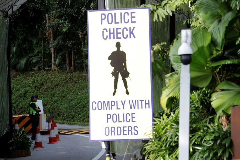 A policewoman stands guard at an entrance to Capella Hotel on Sentosa Island in Singapore