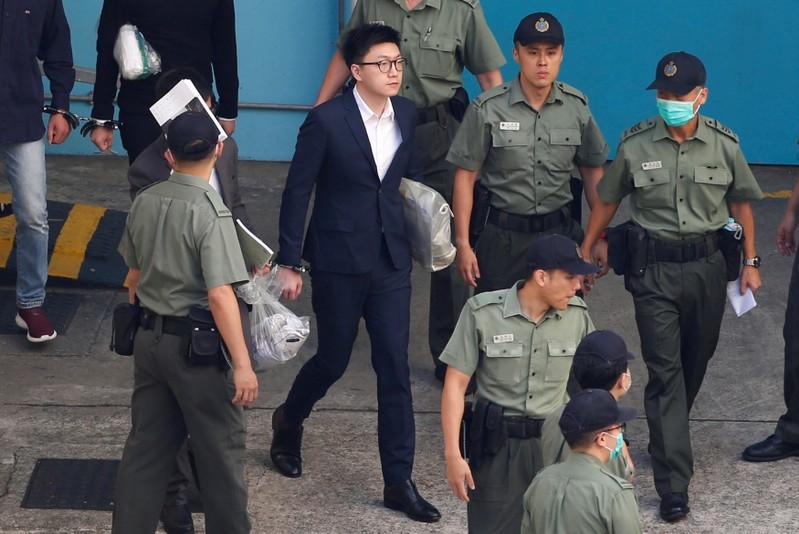 Pro-independence activist Edward Leung walks inside a detention centre in Hong Kong in Hong Kong
