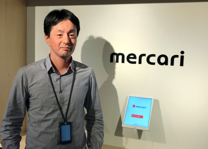 FILE PHOTO - Mercari CEO Shintaro Yamada poses for a photograph during an interview with Reuters in Tokyo
