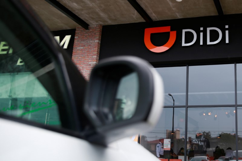 The logo of Chinese ride-hailing firm Didi Chuxing is seen at their new drivers center in Toluca