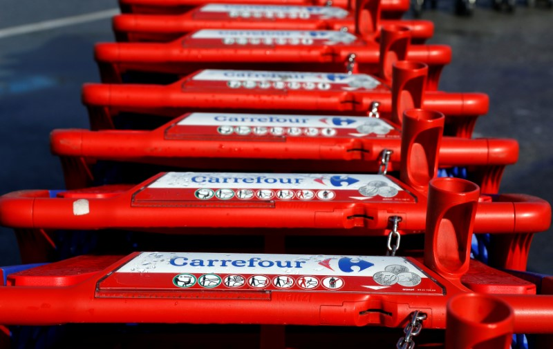 The logo of Carrefour is seen on shopping trolleys at the Carrefour Lingostiere in Nice