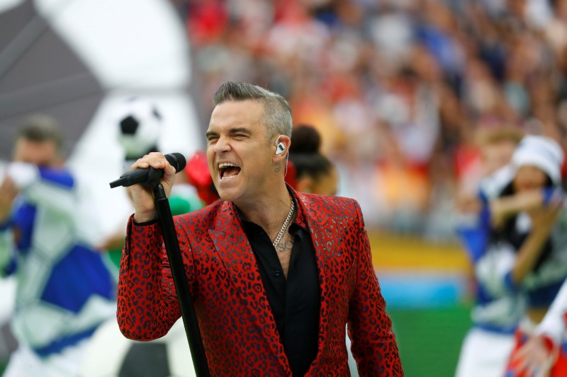 Robbie Williams steals the show but 'flips the bird'
