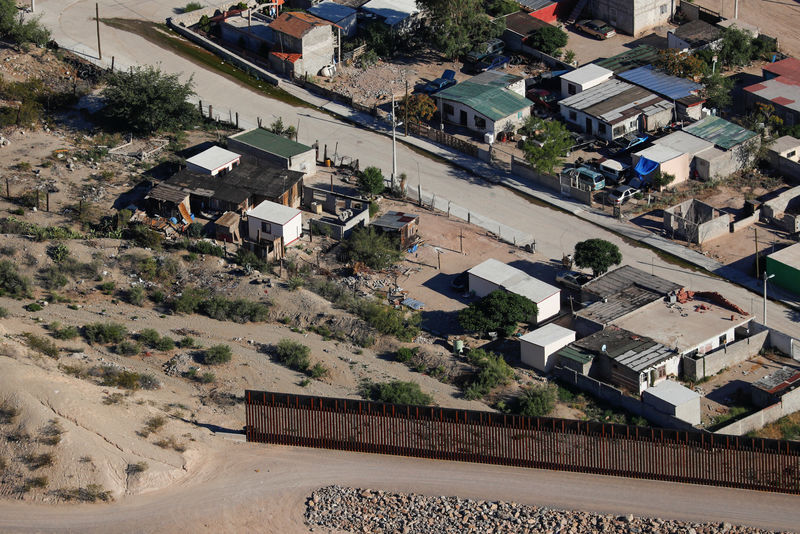 A U.S. border fence between Mexico and the United States ends in the back yard of homes in Juarez, Mexico next to Sunland Park, New Mexico,