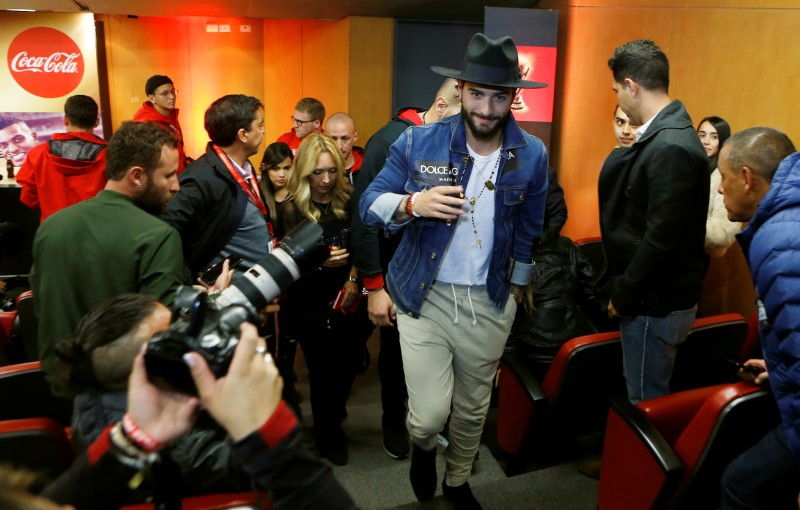 Colombian singer Maluma, leaves after a news conference as part of the world tour of the FIFA World Cup trophy in Bogota