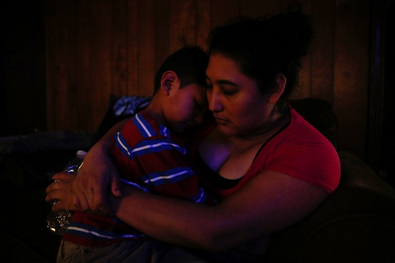 Morena Vasquez comforts her son Isai Rodriguez, 5, at their home in Rome, Georgia