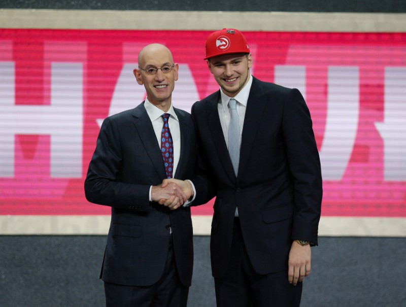 FILE PHOTO: Luka Doncic greets NBA commissioner Adam Silver after being selected as the number three overall pick to the Atlanta Hawks in Brooklyn