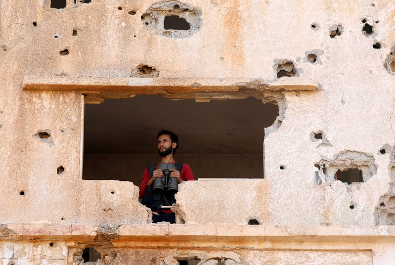 FILE PHOTO: A fighter from the Free Syrian Army is seen in Yadouda area in Deraa