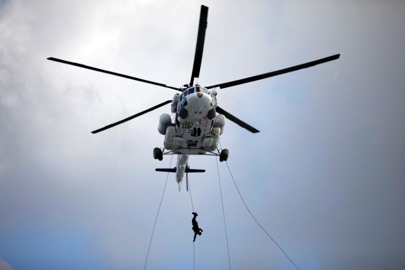 FILE PHOTO: A member of Special Weapon and Tactics (SWAT) rappels down during an anti-terror drill as a part of the Ulchi Freedom Guardian exercise in Goyang
