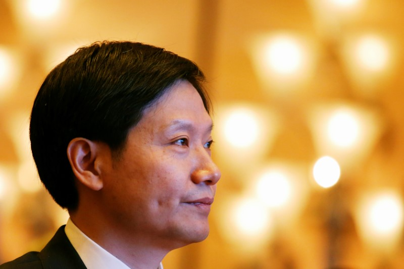 Xiaomi founder Lei Jun attends a news conference in Hong Kong