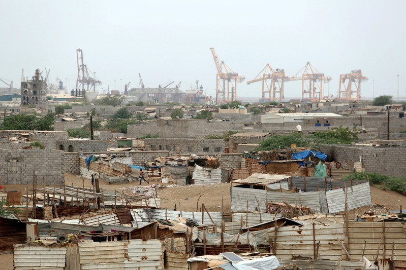 FILE PHOTO: Hodeidah port's cranes are pictured from a nearby shantytown in Hodeidah