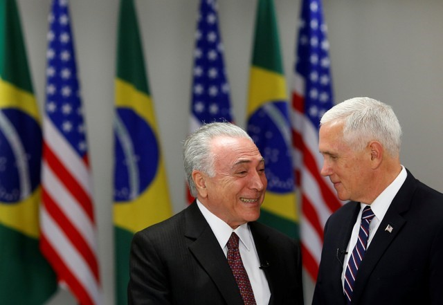 U.S. Vice President Mike Pence and Brazil's President Michel Temer smile during a meeting in Brasilia