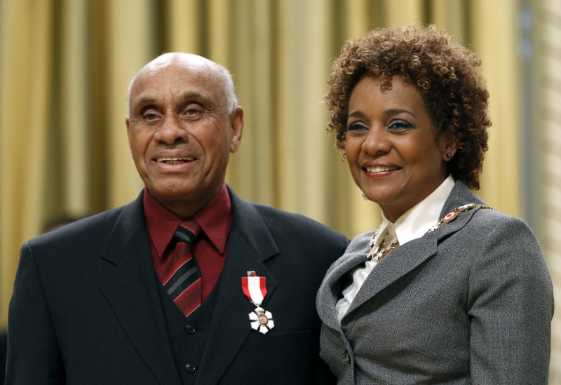 FILE PHOTO: Former ice hockey player Willie O'Ree smiles after being awarded the rank of Member in the Order of Canada by Governor General Michaelle Jean at Rideau Hall in Ottawa