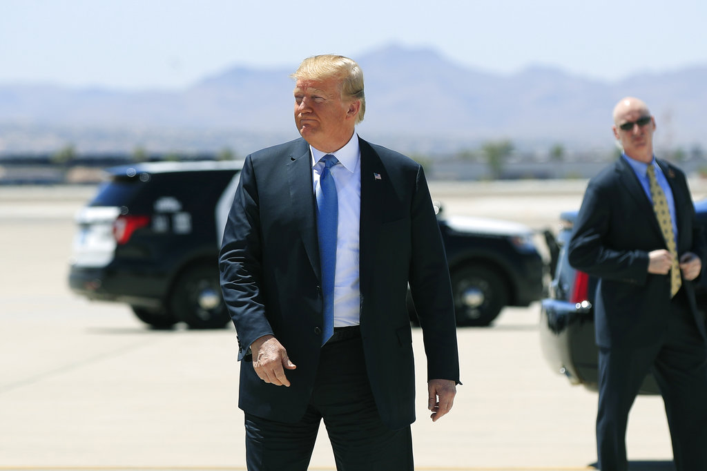 President Donald Trump arrives at Mc Carran International Airport in Las Vegas Saturday