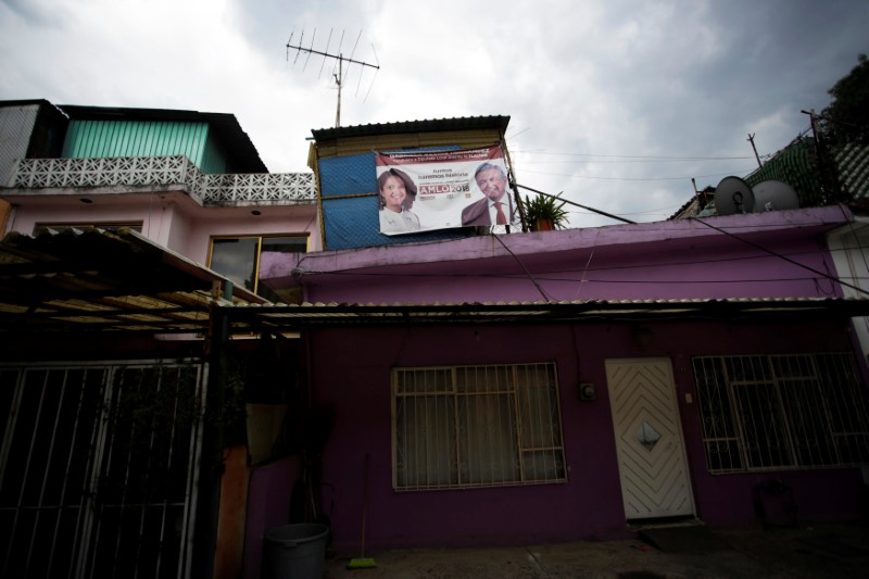 A campaign banner featuring an image of Mexico's presidential election front-runner Andres Manuel Lopez Obrador of MORENA is displayed outside a house before the upcoming July 1 presidential election, in Mexico City