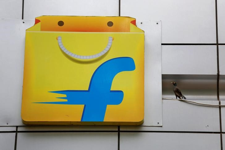 FILE PHOTO: A Common myna sits next to the logo of India's e-commerce firm Flipkart installed on the company's office in Bengaluru