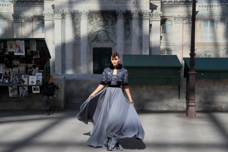 A model presents a creation by German designer Karl Lagerfeld as part of his Haute Couture Fall/Winter 2018/2019 collection show for fashion house Chanel at the Grand Palais in Paris