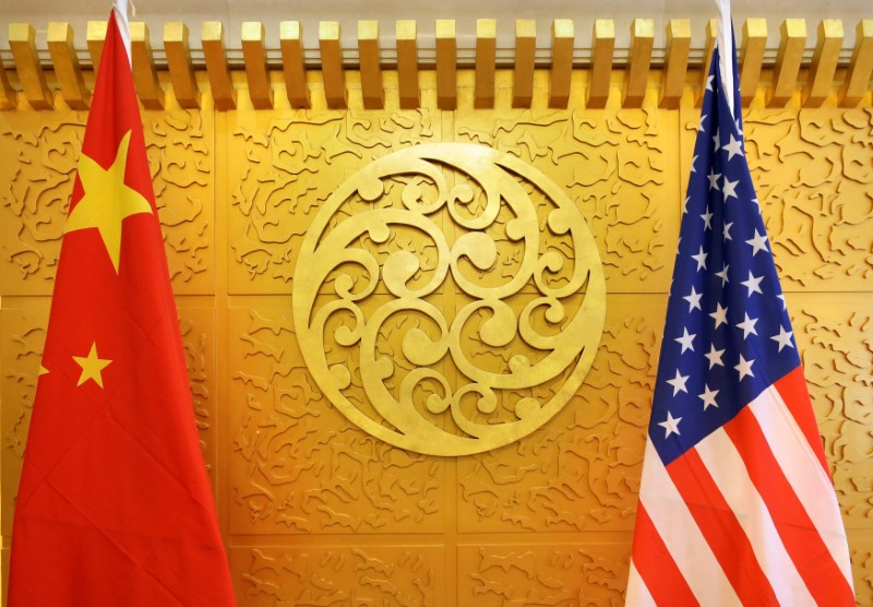 China tries to ease fears that Beijing may target United States  firms