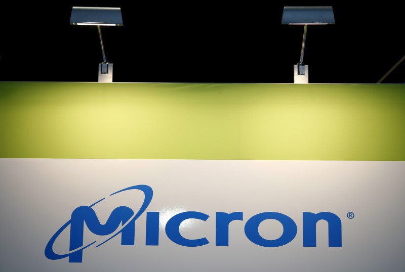 FILE PHOTO: FILE PHOTO: The logo of U.S. memory chip maker MicronTechnology is pictured at their booth at an industrial fair in Frankfurt