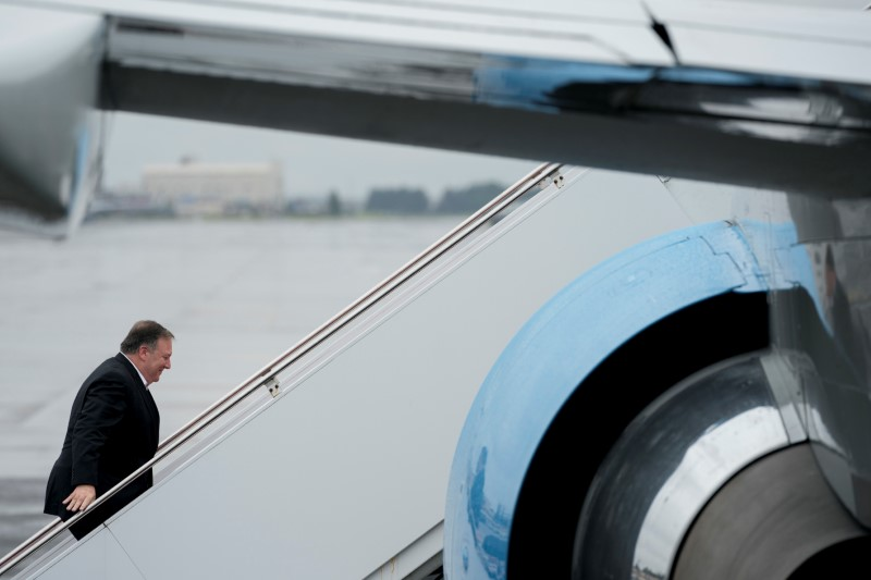 U.S. Secretary of State Mike Pompeo boards his plane at Yokota Air Force Base in Fussa, Japan, for a refueling stop on his way to Pyongyang