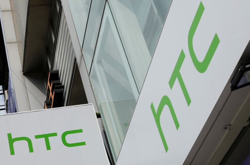 Logos of HTC are seen outside its store in Taipei