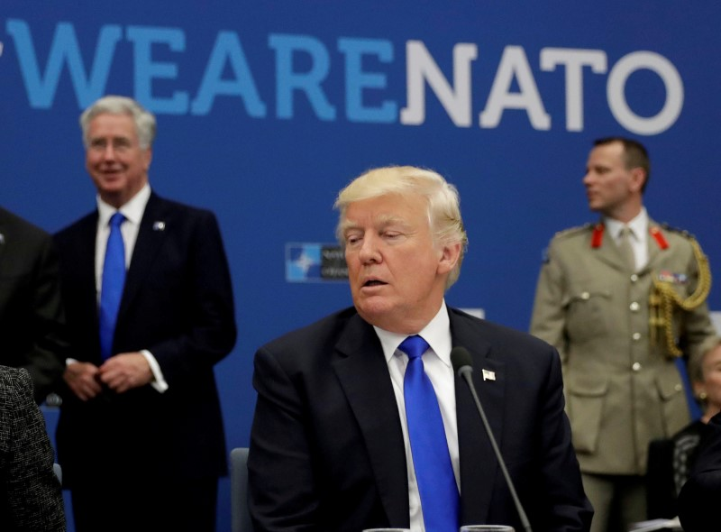 FILE PHOTO: U.S. President Donald Trump attends a working dinner meeting at the NATO headquarters in Brussels