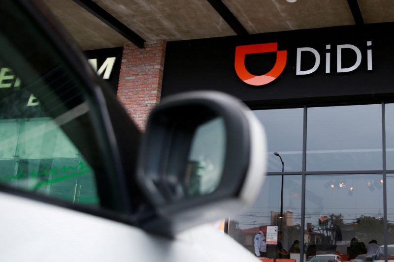 FILE PHOTO: The logo of Chinese ride-hailing firm Didi Chuxing is seen at their new drivers center in Toluca