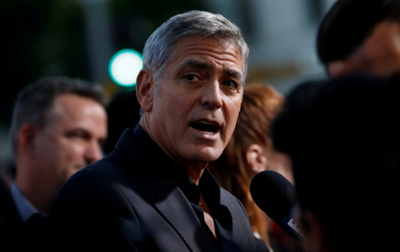 FILE PHOTO: Director Clooney is interviewed at the premiere for
