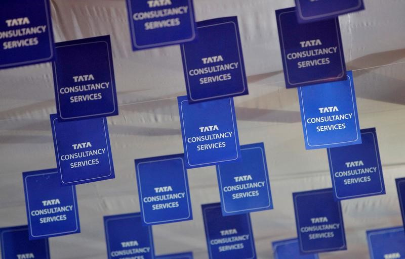 FILE PHOTO: Logos of TCS are displayed at the venue of the annual general meeting of the software services provider in Mumbai