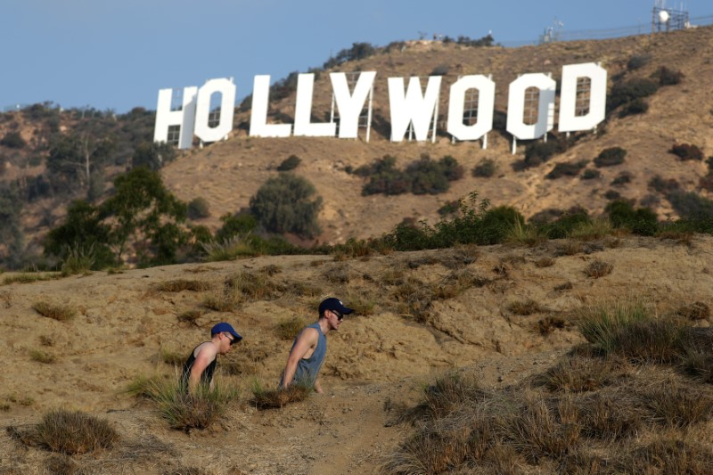 FILE PHOTO:    Hikers pass by the Hollywood sign in Hollywood
