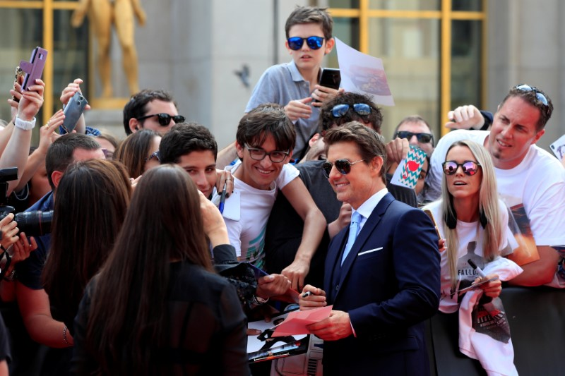 Cast member Tom Cruise poses for cinema fans as he arrives for the world premiere of